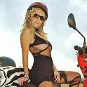 The hot blonde returns. This time she's got a red moped and see thru black lingerie!