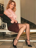 Sexy Betsy Struts Her Long Legs In Stockings.