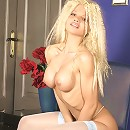 Busty blonde tart poses in tight blue stockings