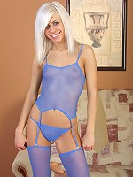 Hot blonde in blue tights plays with a huge dildo