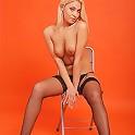 Tall teenage model posing in sexy black stockings