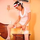 Stockinged housemaid rides a humongous rubber rod