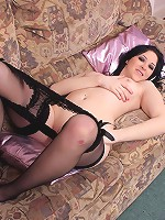 Naughty cutie with perfect legs in black stockings