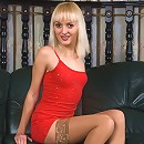 Raunchy blondie posing in nothing except stockings