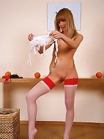 Slim teen tart in white stockings on garter belts