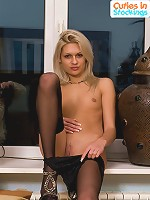 Blonde with perfect body spreads stockinged legs