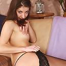 Tall tattoed model posing in sexy black stockings