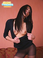 Thin cutie with jet black hair poses in her nylons