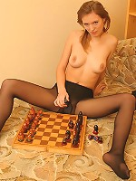 Teen in patterned pantyhose plays with a sex toy