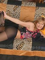 Young nympho rubs pussy through sheer black nylon