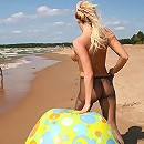 Busty blondie poses in nylons only at the beach