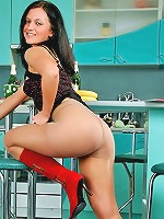 Girl in shiny tights and red boots shows her pride