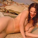 Girl sunbathes at nudist beach in sheer pantyhose
