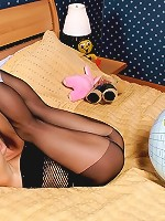 Adorable schoolgirl poses in black tights only