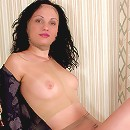 Curly brunette covered with nylon from head to toe