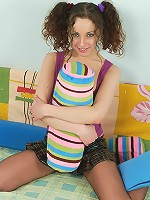 Curly chick massages her smoothie with her tights