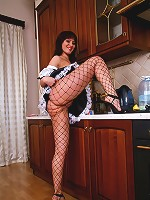 Kinky chambermaid with huge jugs poses in nylons