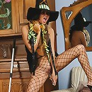 Young witch dildoes herself through fishnet tights