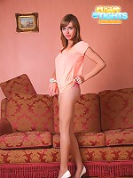 Barely legal girl shows body posing in pantyhose
