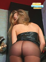 Young blond nylon fetish model looks good in black