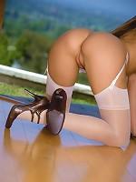 Chekky brunette looks cute in her pleated, tartan miniskirt, glasses and white sheer stockings.