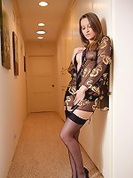 Brunette beauty posing sexy sheer gown and black stockings.