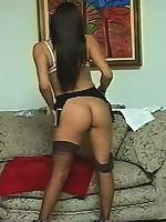 A sassy brunette changes her dark garters for something a little lighter