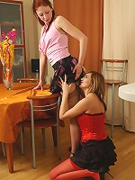 Heated lesbian in red stockings seducing her leggy friend into French sex