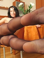 Luscious babe worshipping her feet in reinforced toe pantyhose at the cafe