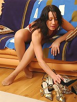 Sweltering brunette in soft silky pantyhose tasting her newly bought shoes