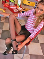 Upskirt babe in open toe shoes showing her long pantyhosed legs in sexy way