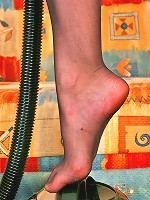 Freaky babe revealing new way of vacuuming with her feet clad in nylon hose