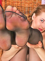 Lewd babe in black sheer-to-waist pantyhose sniffing and licking her shoes