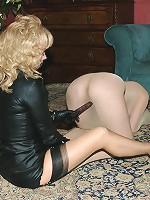 Encased brunette toyed by blonde