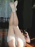 Encased brunette stuffs nylons and heels