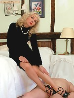 Blonde forces slave footjob