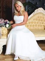 Slutty Lana is wearing a wedding dress and masturbating