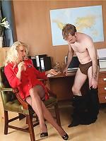 Blonde office slut Lana gives her staff a footjob