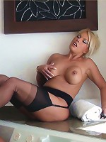 Leggy Lana gets her stockings wet and her mouth filled with cock