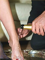 My butler gives me a treat by bathing my feet in champagne