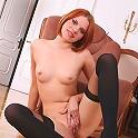 Redhead babe Masha in black thigh highs