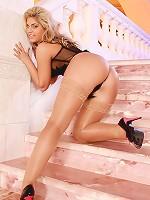Sexy blonde Jill teasing in tan bronze stockings