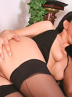 Brunette stocking babe Julia gets double drilled in her black stockings