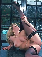 Chubby unshaved blonde in black stockings spreading wide exposing twat