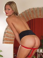 Alluring blonde in red hot stocking showing off sexy body