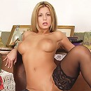 Sexy blonde vixen in black stockings rubbing and caressing hot body