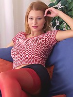 Kinky redhead in red stockings undressing exposing kickass body