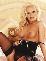 This platinum blonde with the red fingernails is wearing black lingerie and stockings just for YOU.