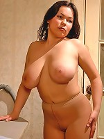 Big boob housewife posing in her brown pantyhose