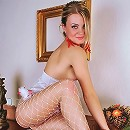 Sweet puffy nipple amateur reveals succulent pussy behind white fishnet pantyhose